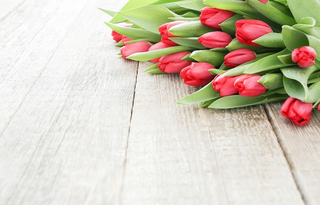 Beautiful bouquet of tulips on wooden table