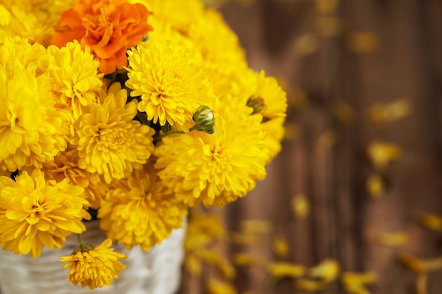 Beautiful bouquet of yellow chrysanthemums flowers in wicker basket
