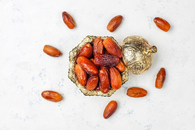 Beautiful bowl full of date fruits symbolizing ramadan, top view