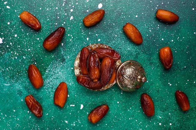 Beautiful bowl full of date fruits symbolizing ramadan, top view