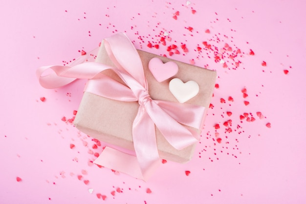 Beautiful box with satin ribbon, with small hearts, chocolate hearts of milk chocolate.