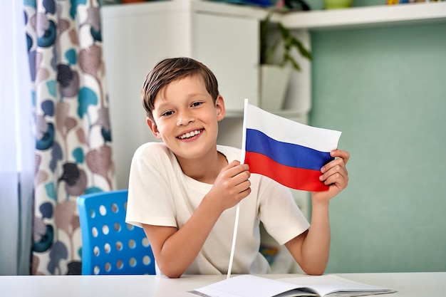 A beautiful boy with the flag of russia day