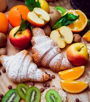 Beautiful breakfast. milk fruits, bread and croissant.