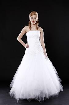 Beautiful bride over black wall
