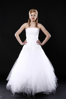 Beautiful bride over black wall