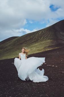 Beautiful bride in an elegant white wedding dress on a lush nature