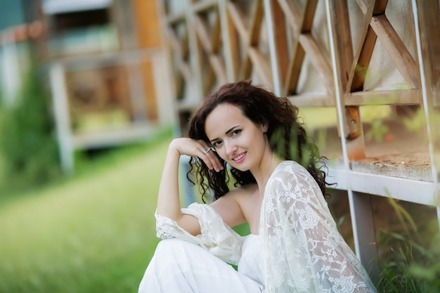 Beautiful bride in gorgeous white wedding dress standing near the lake morskie oko in the mountains on sunny summer day