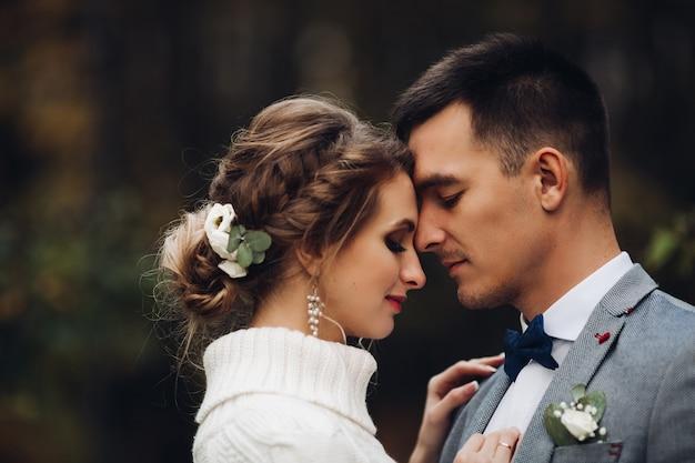 Beautiful bride and groom celebrating wedding at autumn season