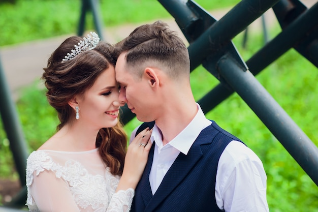Beautiful bride and groom embracing and kissing on their wedding day.