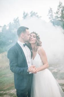 Beautiful bride and groom with smoke bombs.