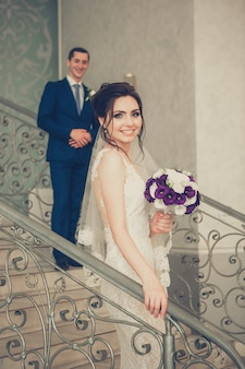 Beautiful bride and handsome groom on stairs