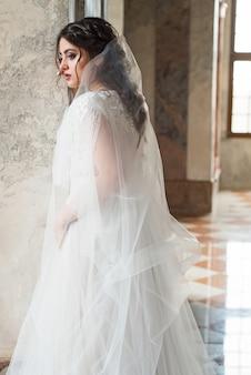 Beautiful bride in luxury baroque interior castel. portrait