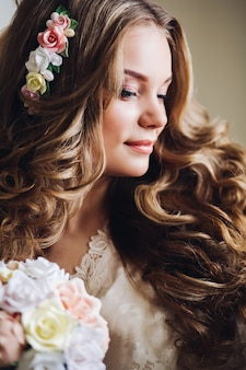 Beautiful bride in the morning in her room