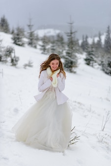 Beautiful bride in a snowy forest