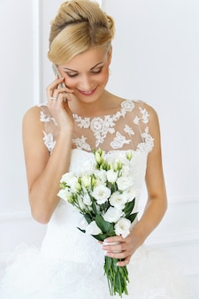 Beautiful bride talking with the phone