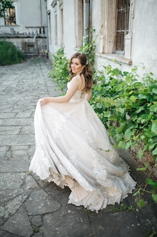 Beautiful bride walks around the town