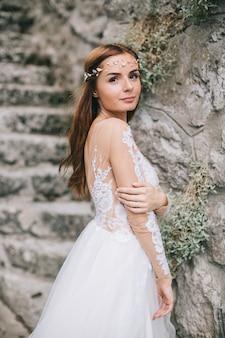 A beautiful bride walks in a fairy austrian town, hallstatt.