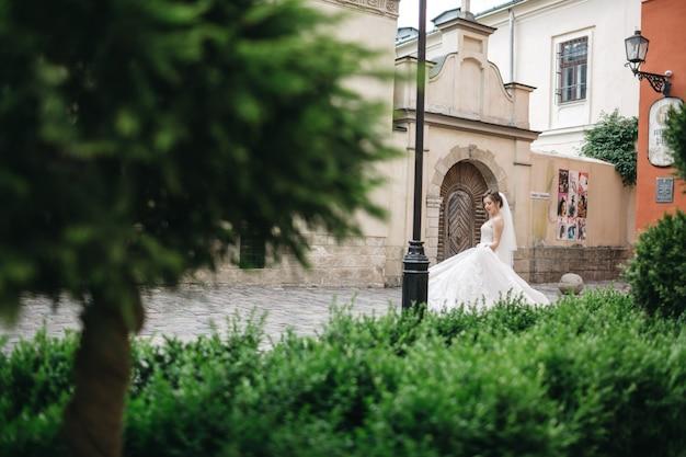 Beautiful bride walks on the wedding day
