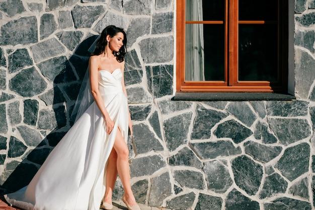 Beautiful bride in wedding dress posing outdoor