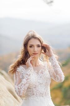 Beautiful bride in white dress posing.