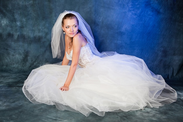 Beautiful bride with fashion hairstyle and make-up in the studio