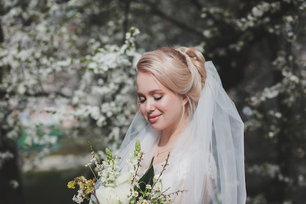 Beautiful bride with fashion wedding hairstyle outdoors. portrait of young gorgeous bride. wedding.
