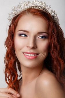 Beautiful bride with red curly long hair.