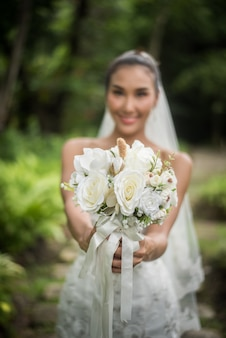 Beautiful bride with wedding bridal bouquet.