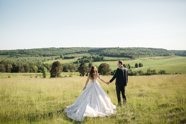 Beautiful brides enjoys nature in the summer
