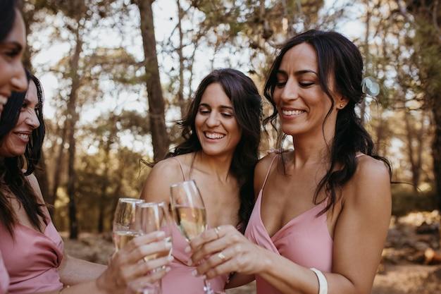 Beautiful bridesmaids having fun outdoors