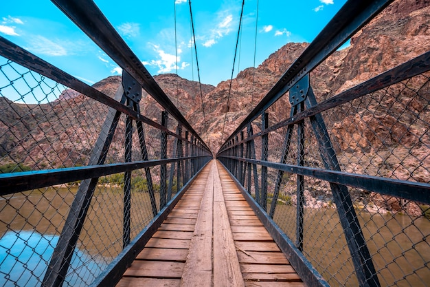 The beautiful bridge that crosses the colorado river at the end of the south kaibab trailhead trek. grand canyon