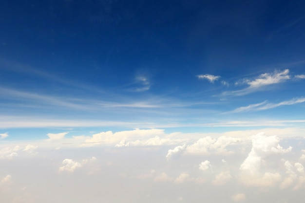 The beautiful bright blue sky background with some white cloud
