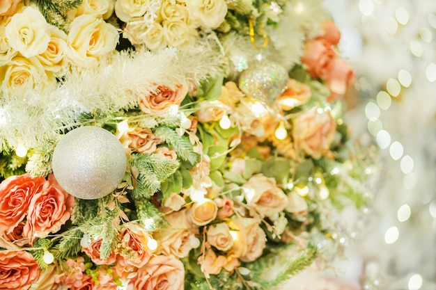Beautiful and bright christmas tree with roses