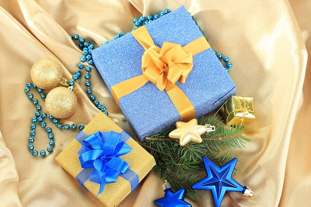 Beautiful bright gifts and christmas decor, on silk cloth