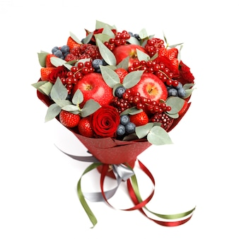 Beautiful bright red edible bouquet of strawberries, pomegranates, apples, blueberries and roses