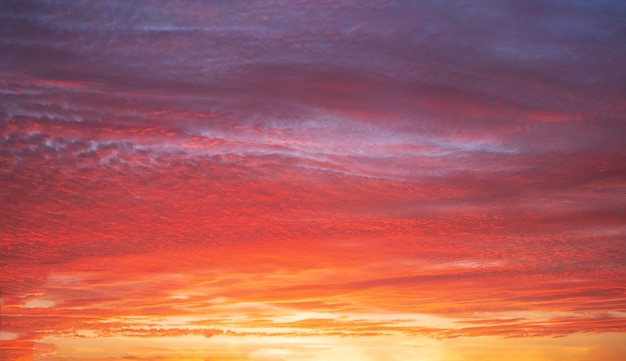 Beautiful bright sunset with multi-colored dramatic clouds