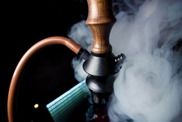 Beautiful brown-black hookah in smoke copyscape