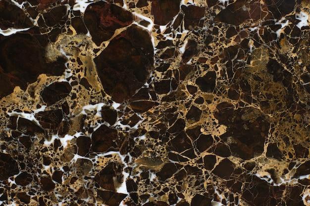 エンペラドールゴールドと呼ばれる白い静脈のある美しい茶色の石の大理石。