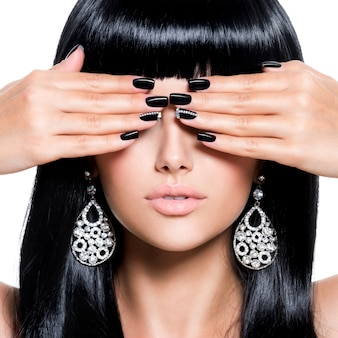 Beautiful brunet woman with black nails