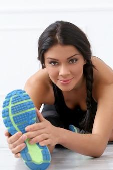 Beautiful brunette doing exercise