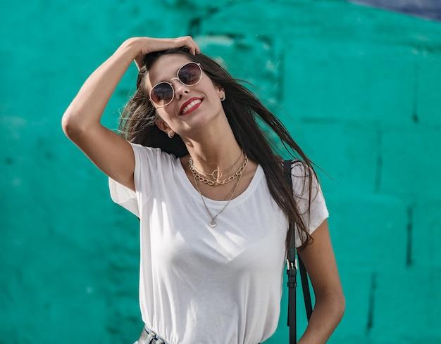 Beautiful brunette female model in dark sunglasses