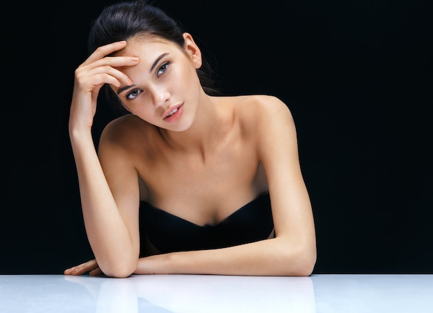 Beautiful brunette girl on black background