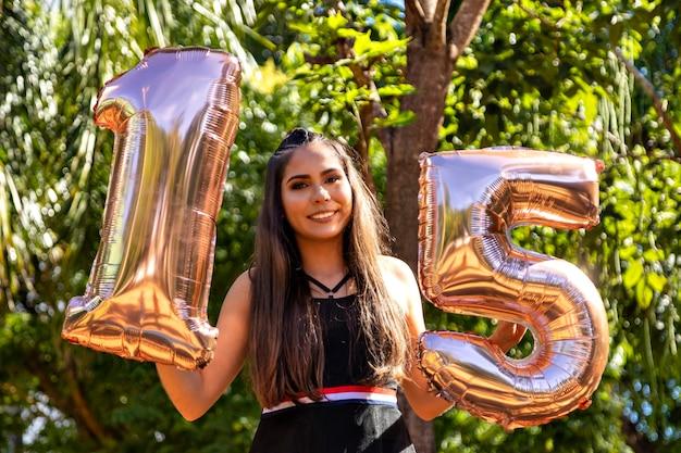 Beautiful brunette girl celebrating 15 years of life, debutante.