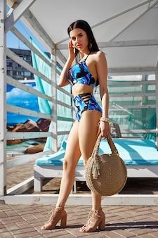 Beautiful brunette girl in a swimsuit