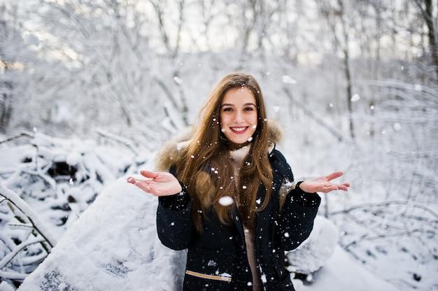 Beautiful brunette girl in winter warm clothing. model on winter jacket.