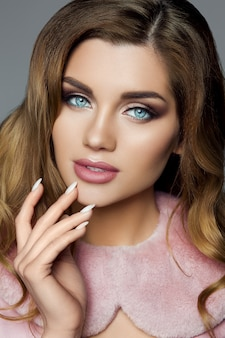 Beautiful brunette girl with professional make-up and pink colla
