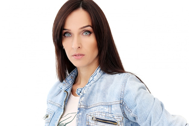 Beautiful brunette in jeans clothes