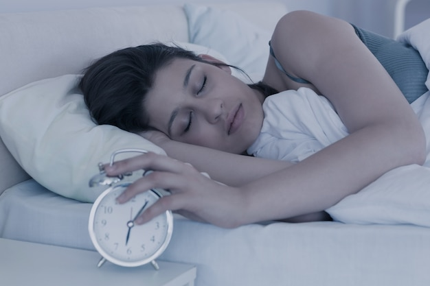 Beautiful brunette sleeping in her bed
