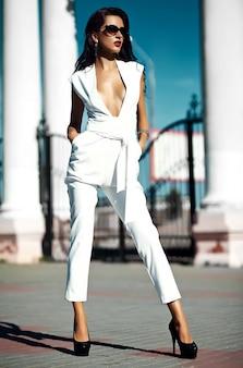 Beautiful brunette on the street wearing white jumper