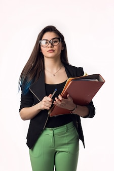 Beautiful brunette student girl in black jacket with papers